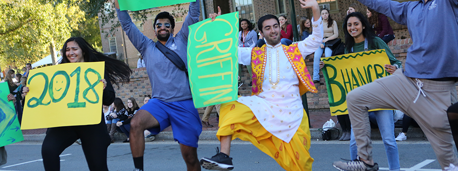 Students in the Bhangra dance troupe perform in the Homecoming parade
